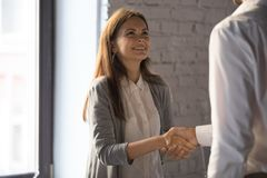 Businessman handshake excited female worker greeting with success royalty free stock images