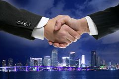 Businessman handshake in Miamy downtown night Royalty Free Stock Image