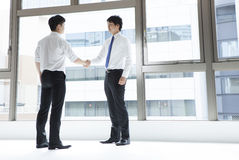 Businessman with a handshake. Photo taken the businessmen have a handshake Royalty Free Stock Image