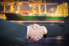 Businessman handshake with ship transportation logistic Stock Photography