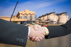 Businessman handshake with silo transportation logistic Stock Photography