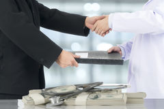 Businessman handshake to deal with the doctor. Stock Photo