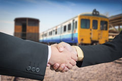 Businessman handshake with train transportation logistic Stock Images