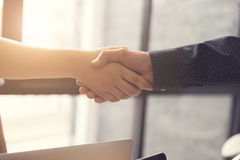 businessman handshaking for business acquisiton concept Royalty Free Stock Images