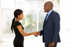 Businessman handshaking businesswoman Royalty Free Stock Photo