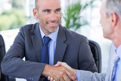 Businessman handshaking colleague Royalty Free Stock Photo