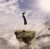 Businessman handstand with laptop by nature Royalty Free Stock Photo