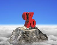 Businessman hanging on red percentage sign with euro peak clouds Royalty Free Stock Image