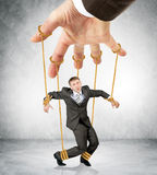 Businessman hanging on strings like marionette Royalty Free Stock Image