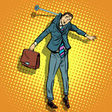Businessman hanging on the wall Royalty Free Stock Image