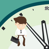 Businessman hangs on an arrow of clock minutes final Stock Images