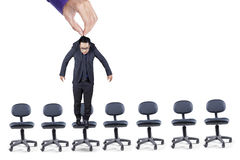 Businessman hangs over office chairs Royalty Free Stock Photo