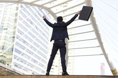 Businessman is happy in the city. Businessman is lifting brief case yelling happily in the city Stock Images