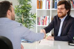 Businessman happy with a client closing deal Royalty Free Stock Photography