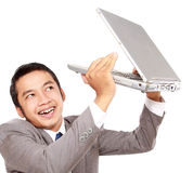 Businessman happy and lift the laptop Royalty Free Stock Photography