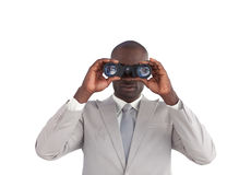 Businessman happy Looking through binoculars Stock Image