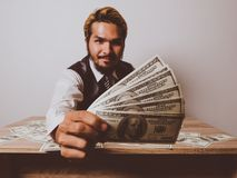 Businessman happy with many dollar banknote, business success co stock images