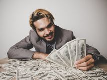 Businessman happy with many dollar banknote, business success co royalty free stock images