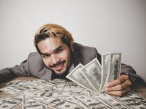 Businessman happy with many dollar banknote, business success co royalty free stock photography