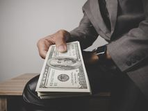 Businessman happy with many dollar banknote, business success co stock photography