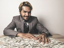 Businessman happy with many dollar banknote, business success co stock image