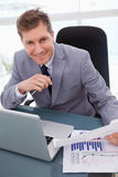 Businessman happy about market research results. Smiling businessman happy about market research results Stock Photos