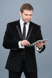 Businessman is happy by the news he is reading on his tablet pc Royalty Free Stock Photos