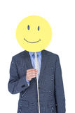 Businessman with happy smiley faced balloon Stock Photography