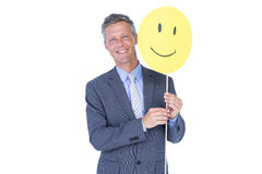 Businessman with happy smiley faced balloon Royalty Free Stock Image