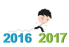 Businessman happy to running from 2016 to 2017. New year success concept , presented in form stock illustration