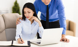 Businessman harassing  colleague in office Stock Images