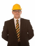 Businessman in hard hat Stock Images