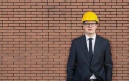 Businessman in hard hat Stock Photo