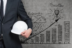 Businessman with hard hat Royalty Free Stock Photography