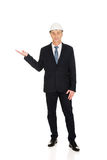 Businessman with hard hat holding copyspace Royalty Free Stock Image