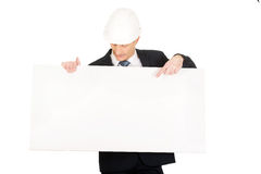 Businessman with hard hat holding empty banner Stock Photography