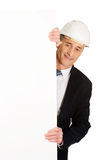 Businessman with hard hat holding empty banner Royalty Free Stock Photos