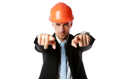 Businessman in hard hat pointing at you Royalty Free Stock Photo