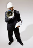 Businessman in hard-hat with walkie-talkie Royalty Free Stock Photography
