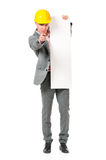 Businessman in hard hat Stock Photography