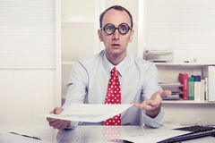 Businessman - hard sell or perplexed handing paper over - stress Royalty Free Stock Image