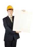 Businessman in hardhat holding banner Stock Photos