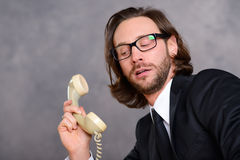 Businessman has a awkward  phone call Stock Photography