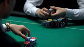 Businessman has chance to win big money playing poker at casino, getting cards. Stock photo royalty free stock photos