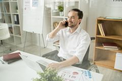Businessman has a conversation on phone royalty free stock photography