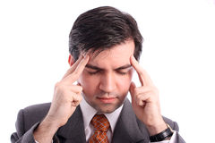 Businessman has a headache Royalty Free Stock Image