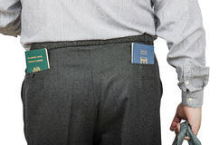 Businessman has Israeli and Tonga passports in his rear pockets. Businessperson has Israeli and Tonga passports in his rear pockets of black wool trousers. View Royalty Free Stock Photography