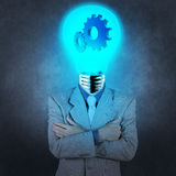 Businessman has  light bulb head with gears Stock Photo