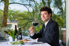 Businessman has lunch in restaurant Stock Photo