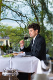 Businessman has lunch in restaurant Stock Images